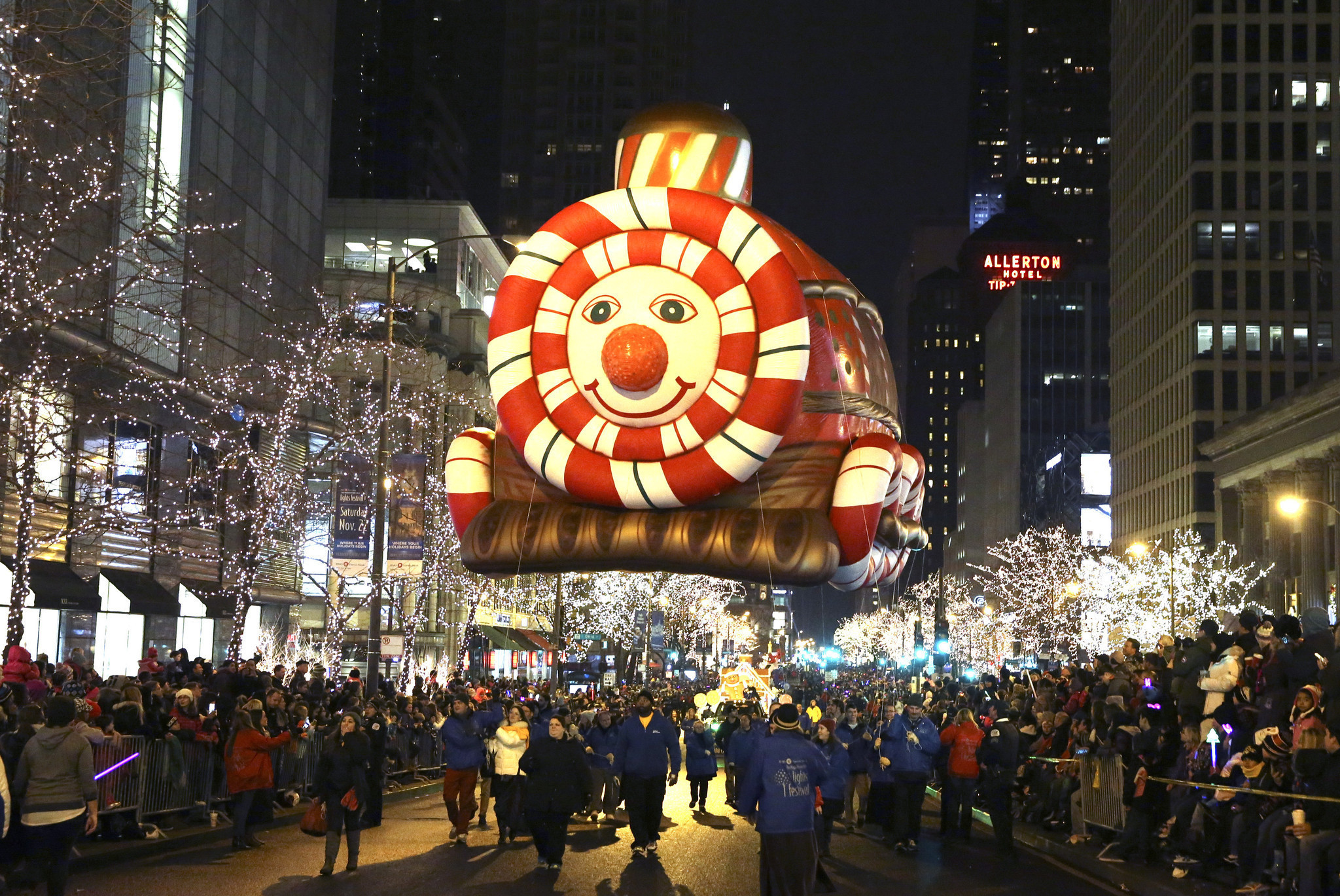 A large balloon is carried southbound on Michigan Avenue, during the Magnificent Mile Lights Festival, on North Michigan Ave., in Chicago, on Saturday, Nov. 22, 2014. (Nuccio DiNuzzo/Chicago Tribune)